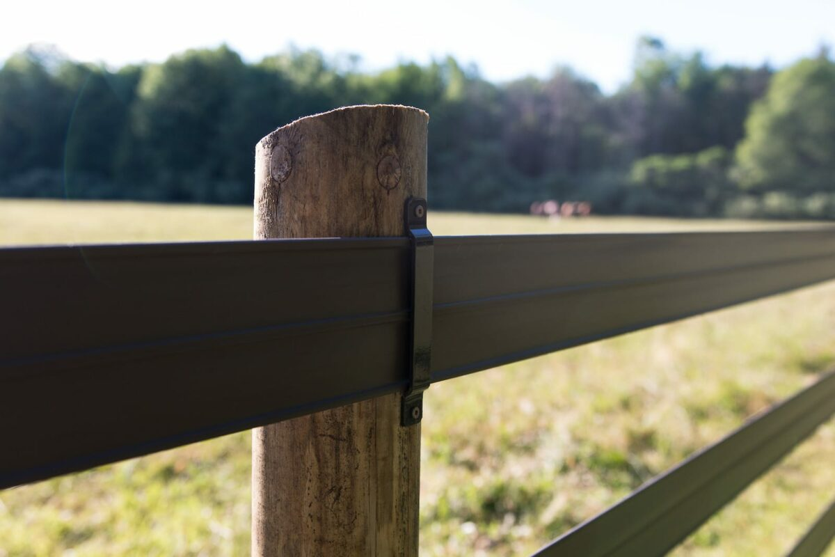 Black fence post- Stock and Noble